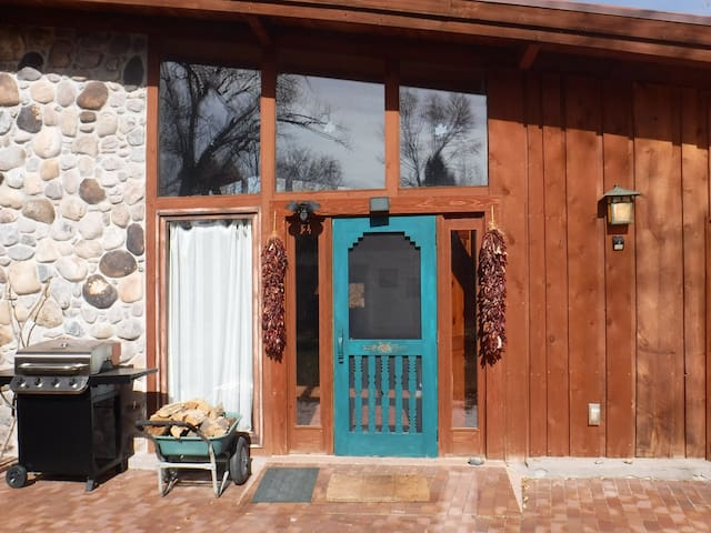 front door with ristras and gas grill