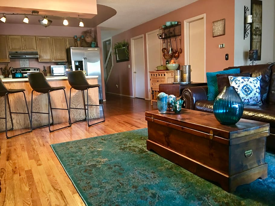 Charming Living Room Looking into Kitchen and Bar