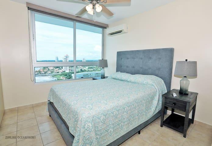 2nd bedroom, queen bed with 18th floor ocean - mountain views