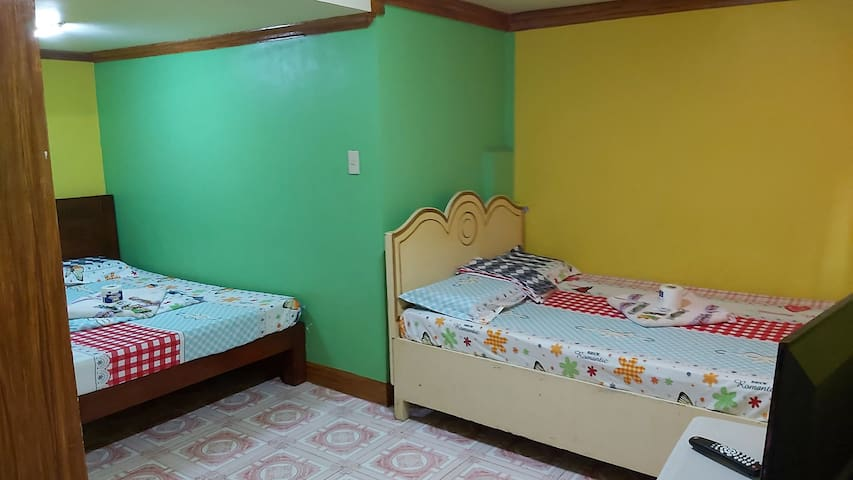 Family Room good for 4 persons. TV/CABLE/WIFI/Hot Shower/Aircon  P300.00 per excess max is 6 (extra bed will be provided)  P1,500 per night.
