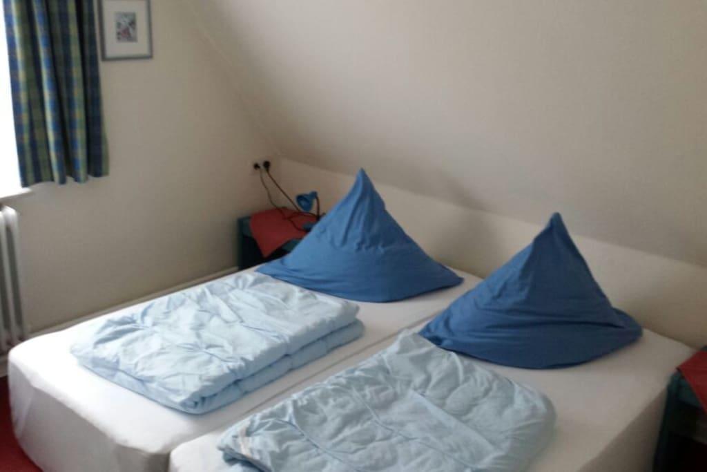 Schlafzimmer Ferienwohnung Flut
