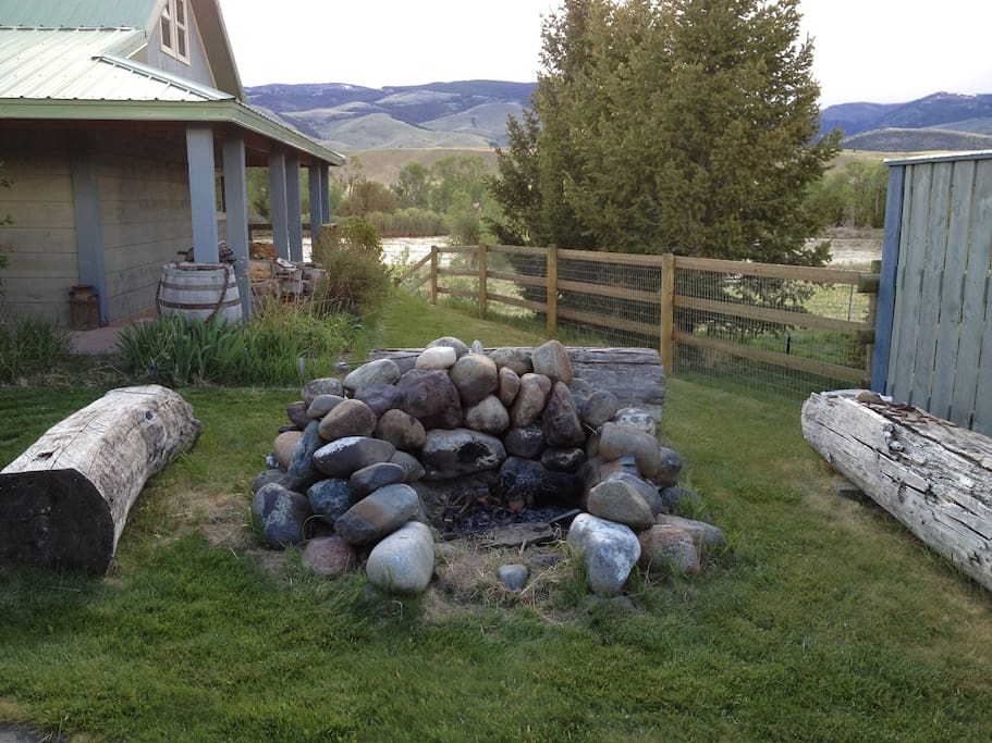 Out door fire pit with log seating.