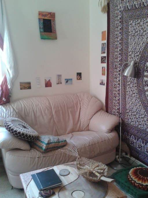 In the room there is a place to sit, read a book, relax and host a friend in privacy