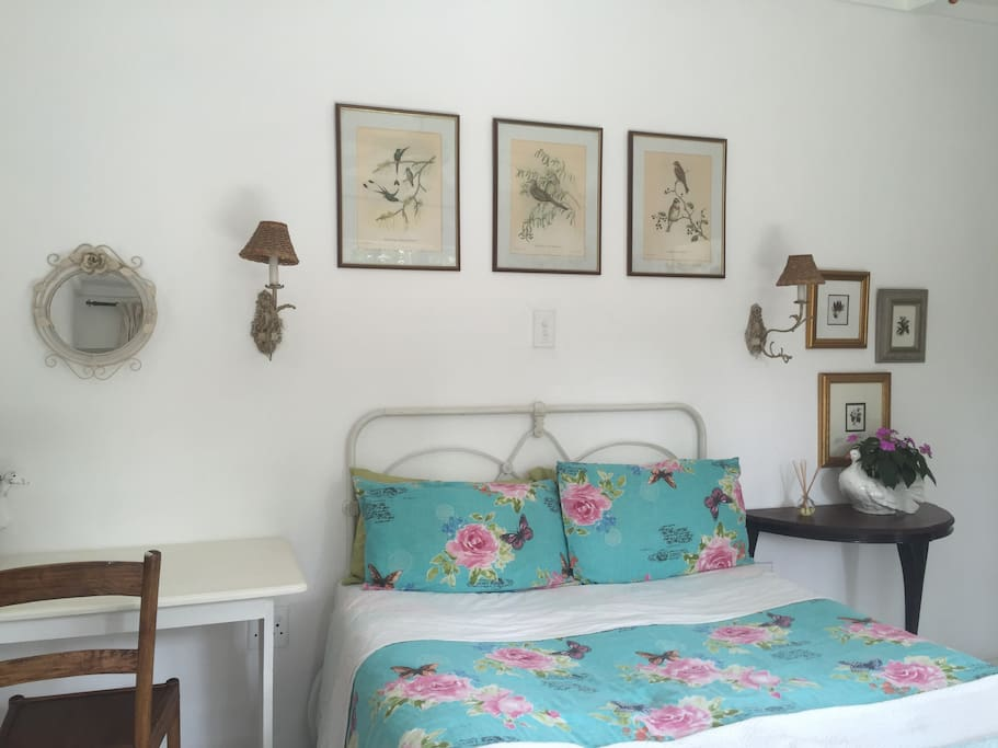 comfy double bed with pretty linen and electric blanket