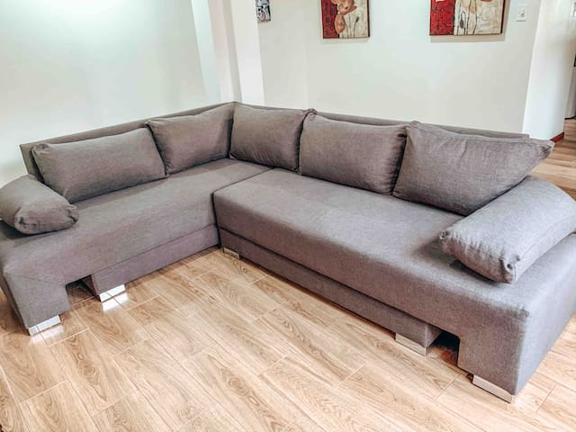The sleeper couch in the second living room.