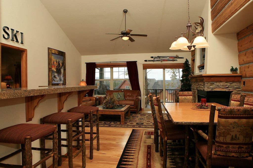 Open kitchen and dining area with bar seating for three