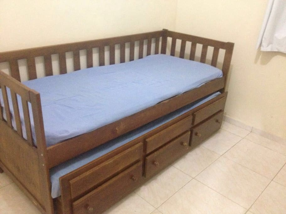 Bedroom 1: it has a big new wardrobe, two beds in one (picture), with excelent mattress, this room has 16 square meters and acomodates up to 3 people (negotiable)