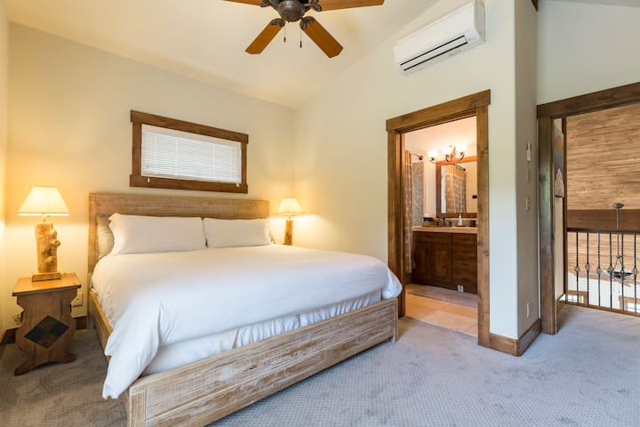 Second Master Bedroom with King Bed, en suite bathroom and a private covered deck with views of the ski mountain.