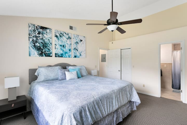 Large Master Bedroom with King Mattress and walk in closet with ensuite. Pack and Play for infants and toddlers included in the closet.