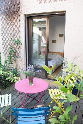 The cute little green room and its charming patio
