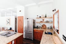 Top of the line Kitchen Aid fridge, Jenn-Air oven in large granite island and Miele dishwasher. (Help yourself to cooking condiments - plenty of equipment here to make a full meal + tea and coffee!)