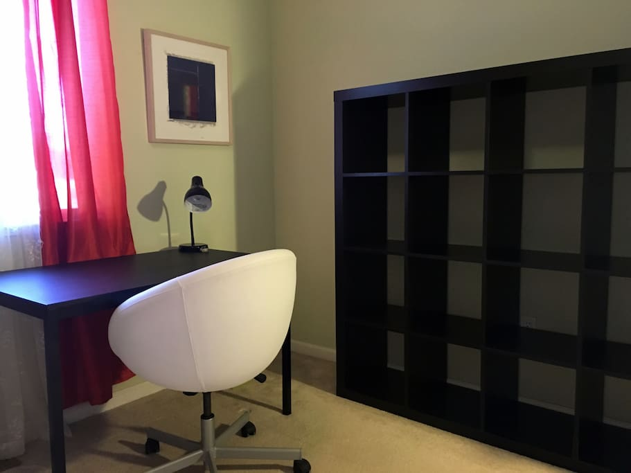 Desk, chair, lamp and bookcase.