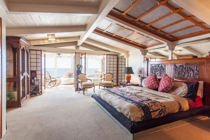 Spacious Master Bedroom with hand-carved teak, flat-screen TV and loads of closet space