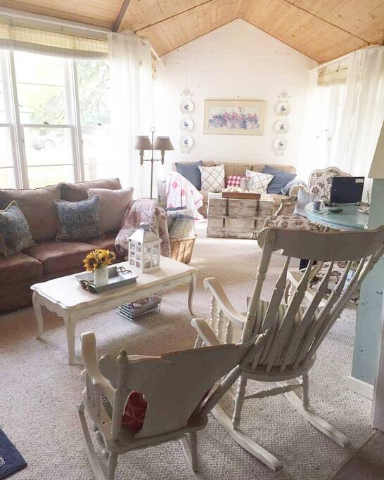 Cozy up and read a good book or play some cards in our sunroom.