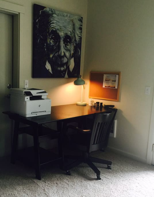 Our home includes a work space with a wireless printer and wifi.