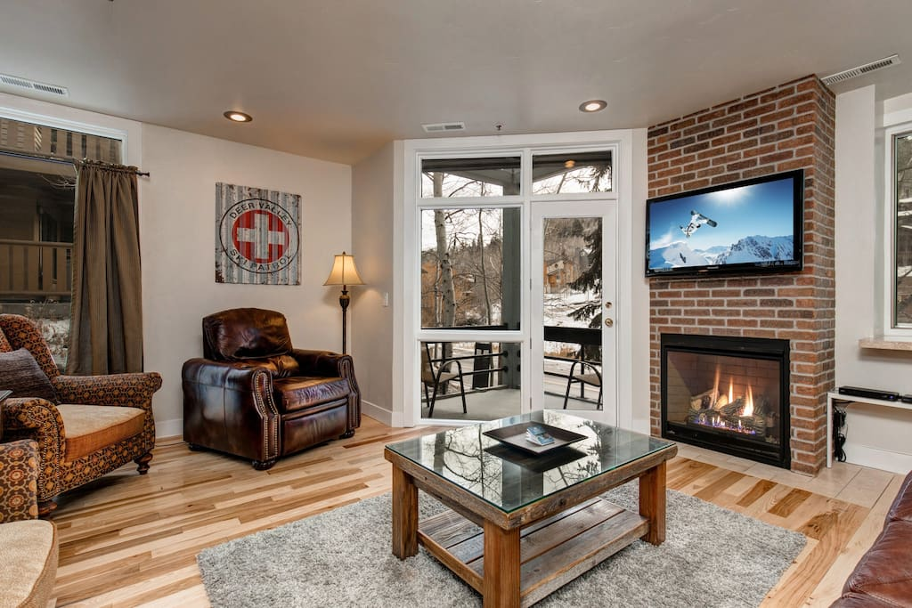 Large Living Room with gas fireplace and HD Smart TV