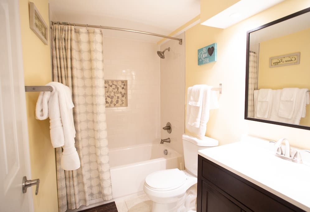Bathroom area with refreshing full shower and soaking tub.  Fresh towels, delicious shampoo, conditioner and body soap provided.