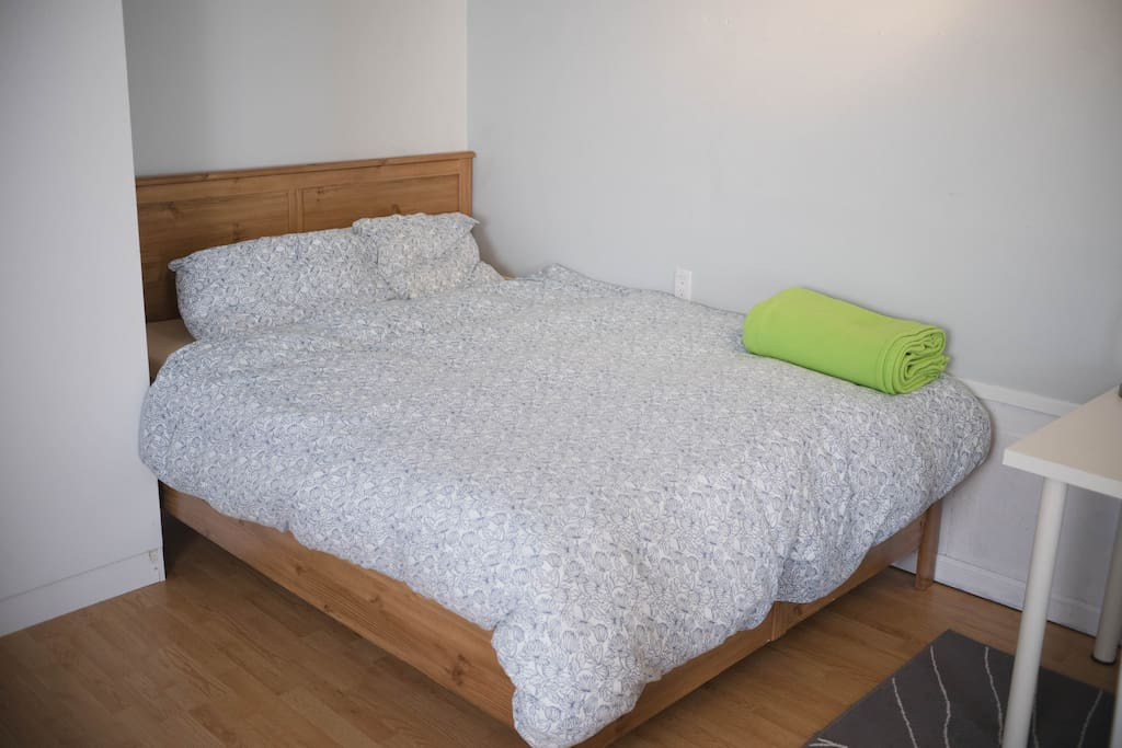 Queen sized bed with comfortable mattress.