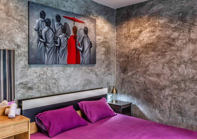 Bedroom 1. Modern design with beautiful local art.