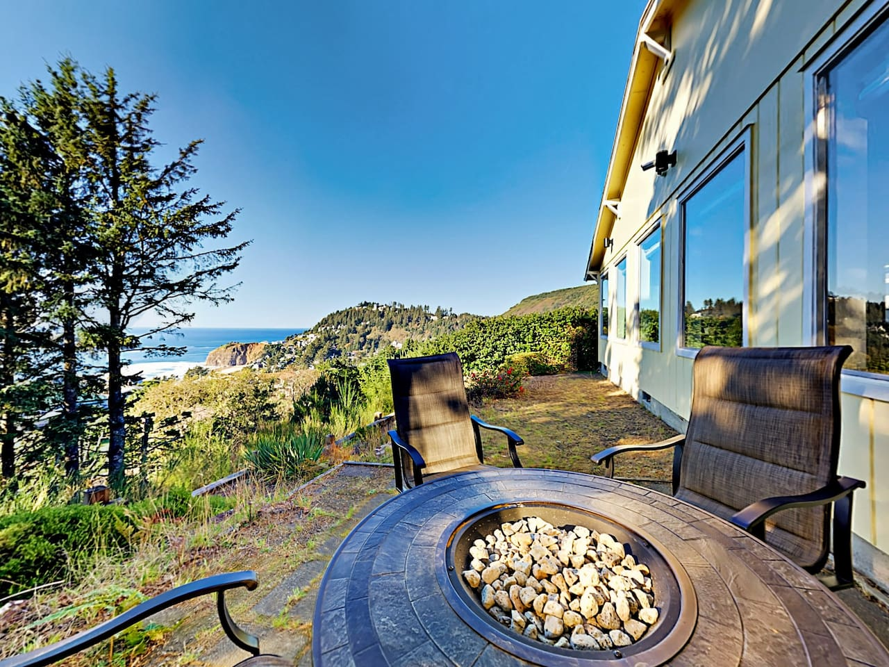 Welcome to Tillamook! Congregate around the backyard fire pit and enjoy views of the Pacific Ocean.