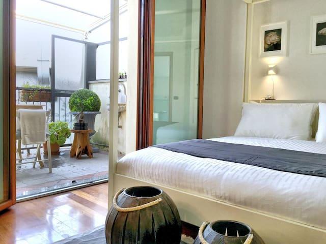 Master Bedroom facing the quiet internal courtyard with terrace access, en-suite