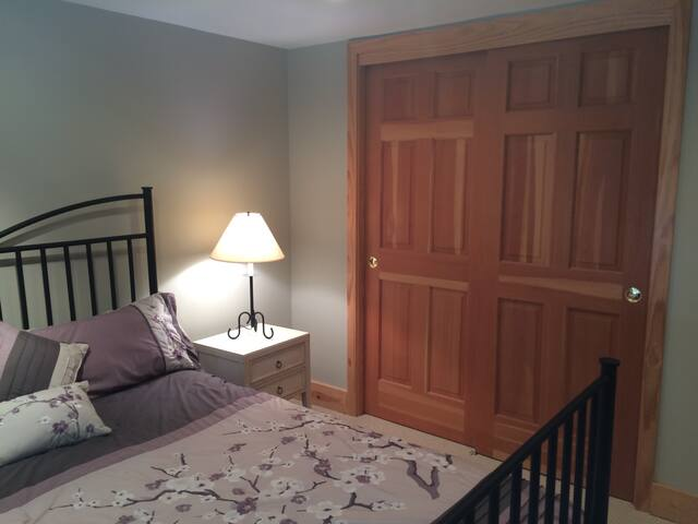 Queen size bed with closet space.