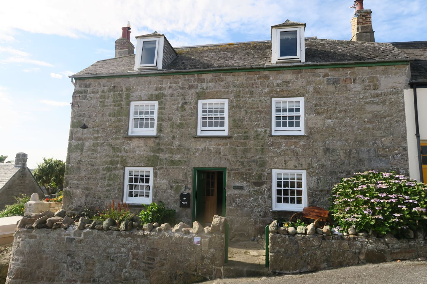 Syllorga House. One of the oldest properties in Hugh town, originally dating to medieval times. Additional storey added in the early 18th century, along with a scantel tiled roof and sash windows..