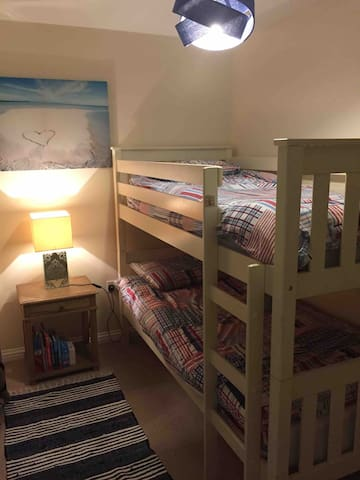 Bunk beds  with prtial sea views from window