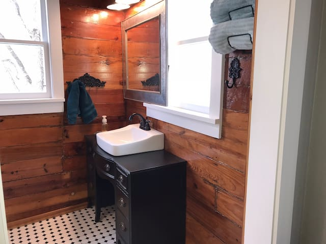 Master bath with original shiplap walls, walk-in shower