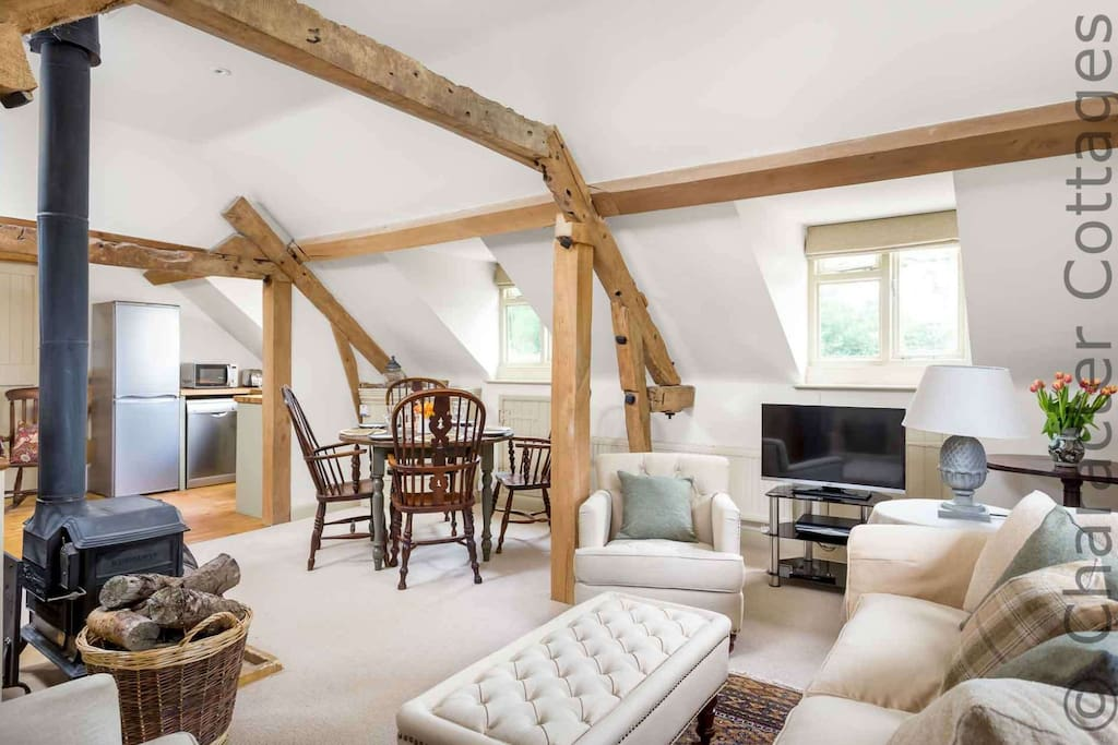 On the first floor is a fabulous open plan living area with wood burning stove