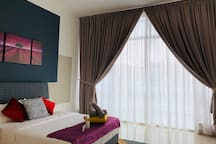 Comfortable and spacious Master Bedroom with balcony and attached bathroom.