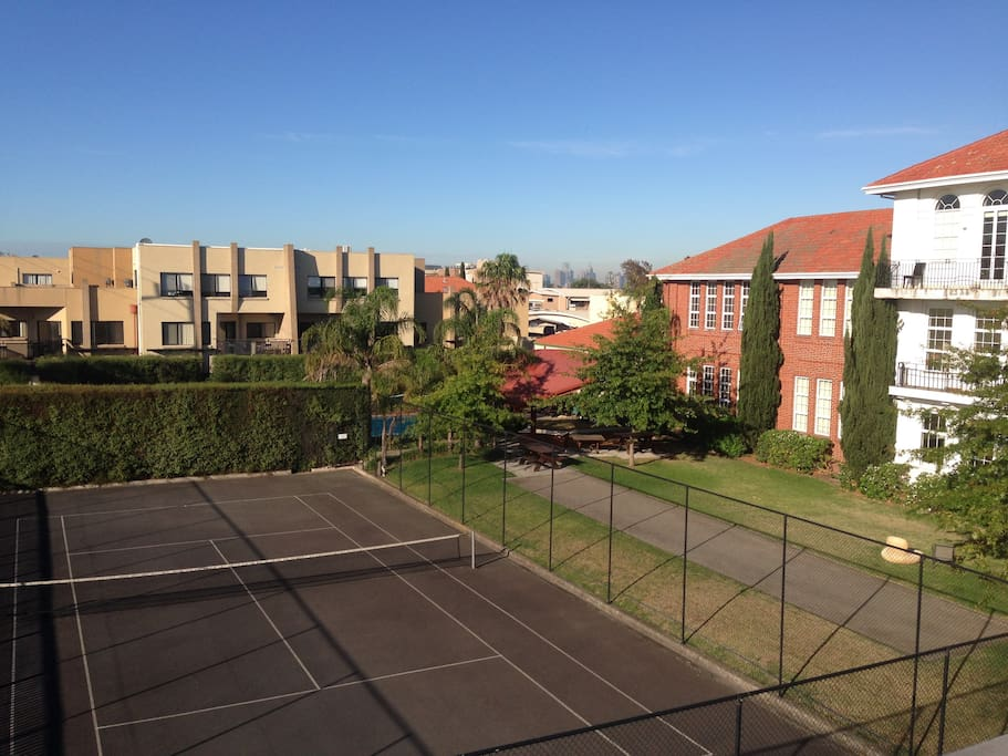 View from Balcony into Complex and Tennis Court