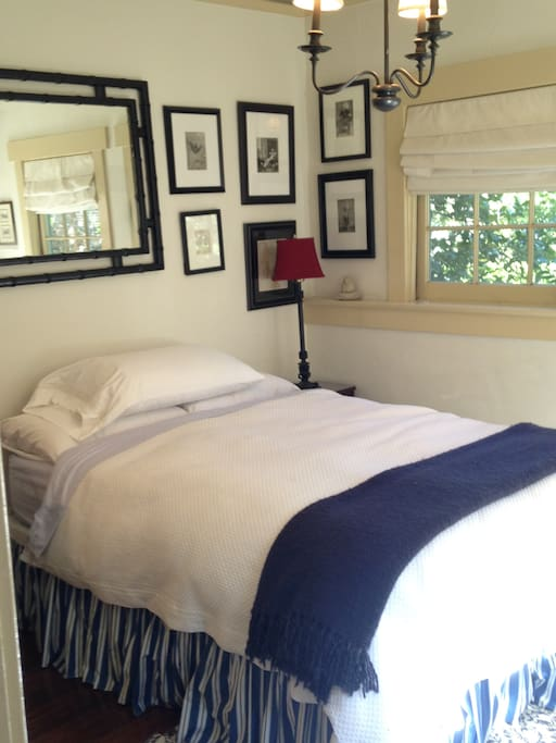 Bright comfy bedroom with immaculate down comforter and quality bedding. Full size bed.