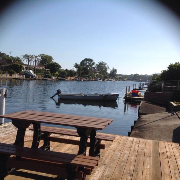 Sunny ensuite room on waterway.