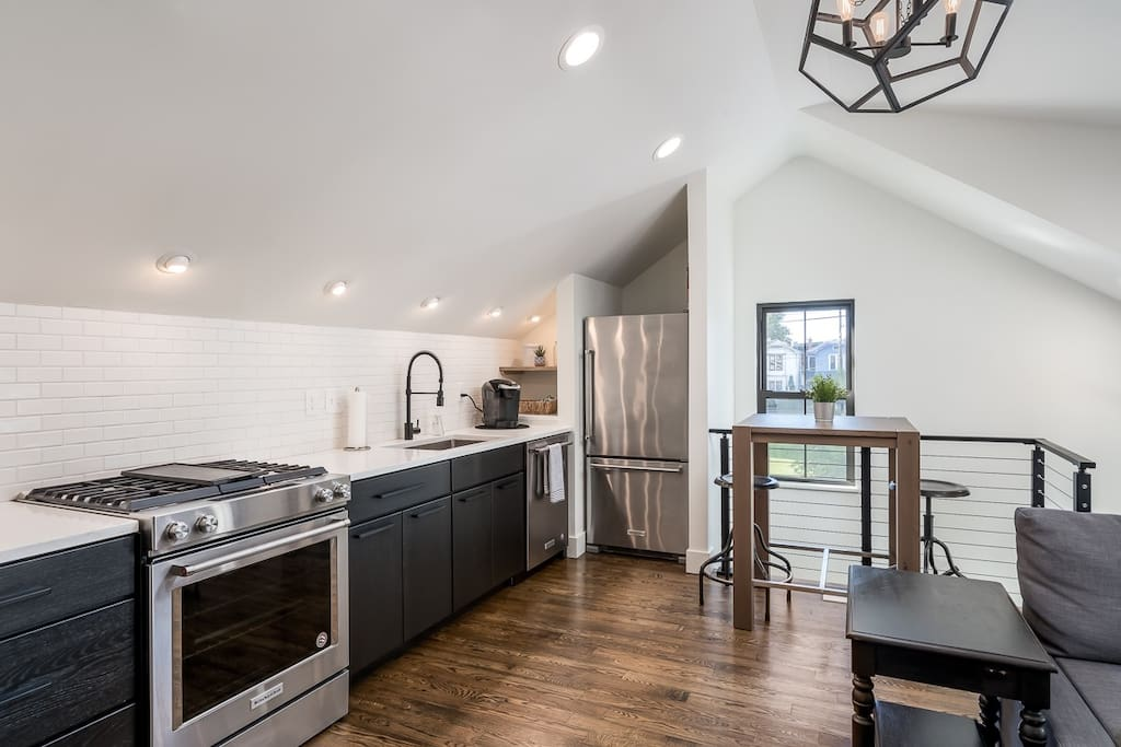 High end kitchen with room to work or eat!