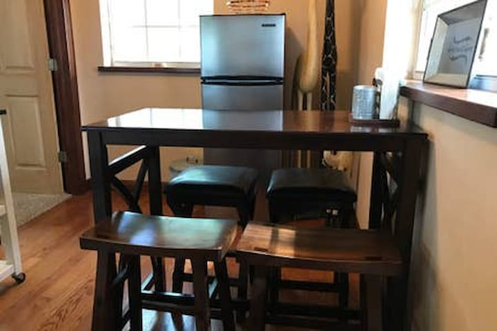 Full size refrigerator and dining table in the kitchen
