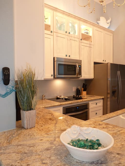 Granite counters and stainless appliances make this fully stocked kitchen a dream!