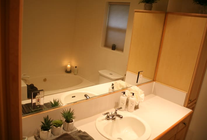 Large bathroom with tub and separate shower.