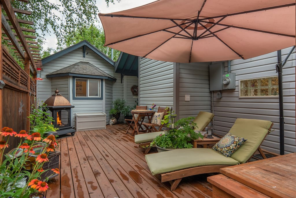 Your side entry deck gives you 2 lounge chairs, a table for two, fireplace and umbrella.