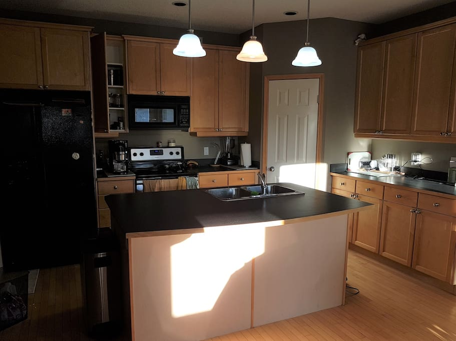 Fully Equipped Shared Kitchen with oak dining table seats six