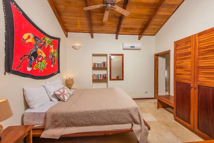 Front bedroom with ocean view. Featuring very comfortable sleeping space on your queen bed, and ensuite full bathroom. A/C and temperature control included.
