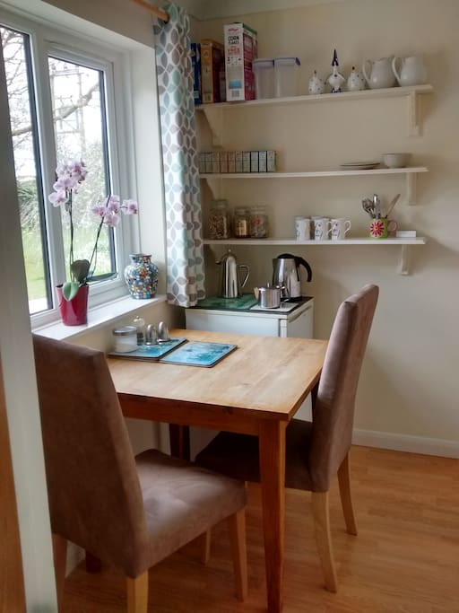 Small private breakfast room with fridge and kettle