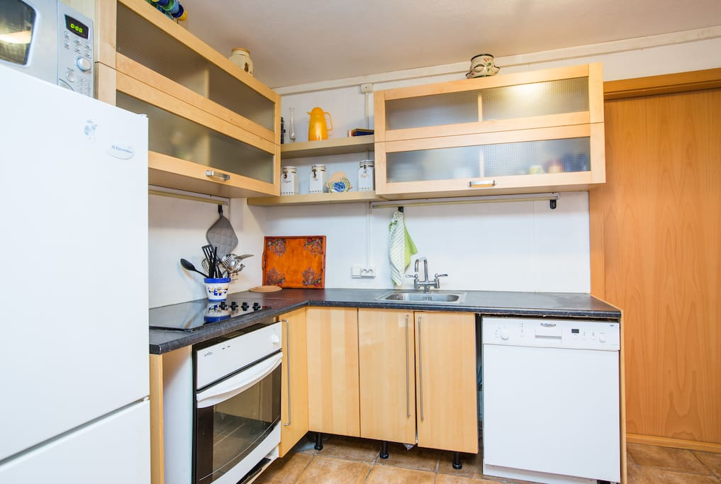 In the kitchen you can find tableware, pots, pans, a toaster, coffee maker and a kettle.