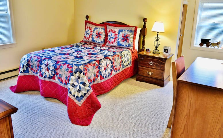 Second bedroom with full size bed, dresser, desk & chair and full size closet boasts views overlooking the private wooded front yard and horse paddock.