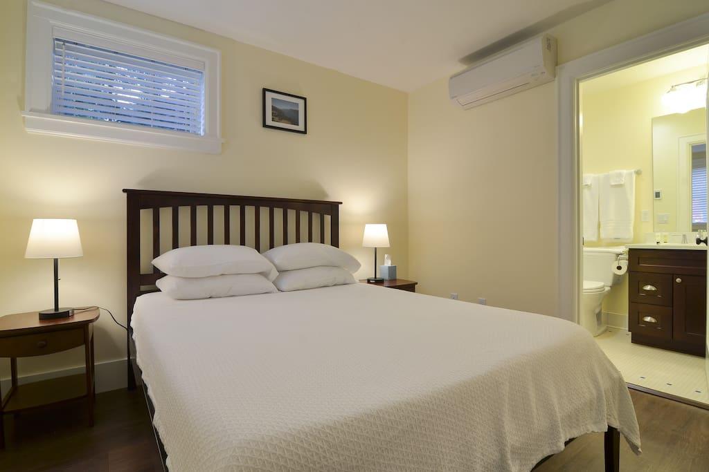 Bedroom 1: Queen bed and ensuite shower bath
