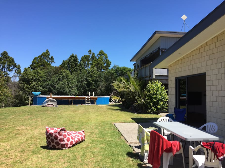 Back lawn with pool and spa apartment above house