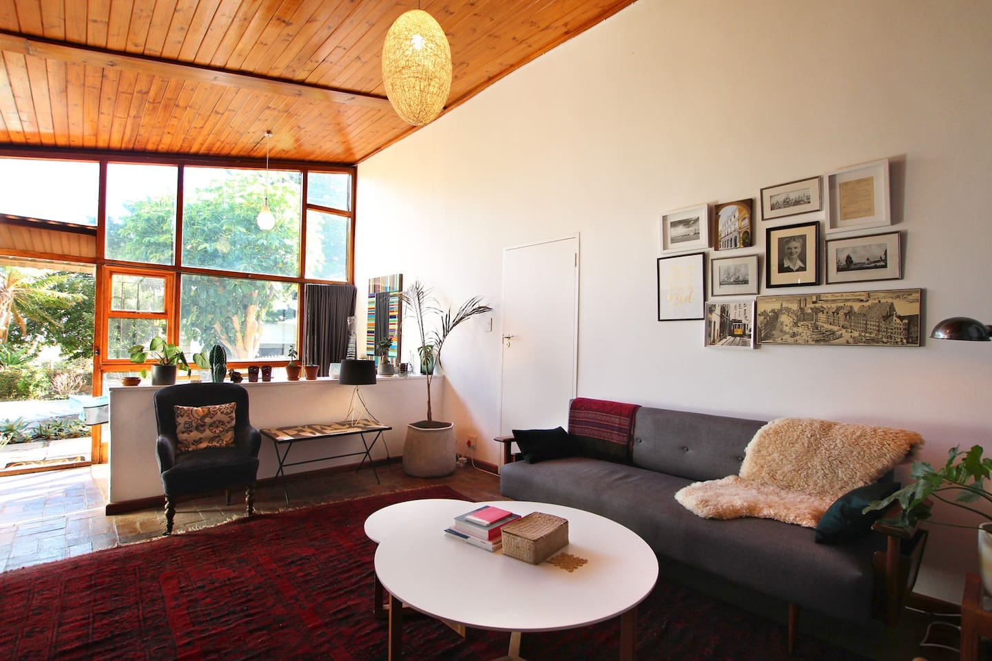 Lounge with couch and two arm chairs, coffee table, side tables and ambient lighting