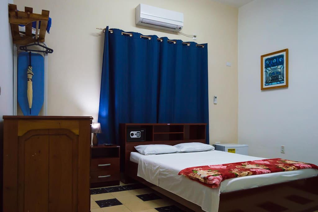 Room 1, double bed, air conditioner, hangers, minibar