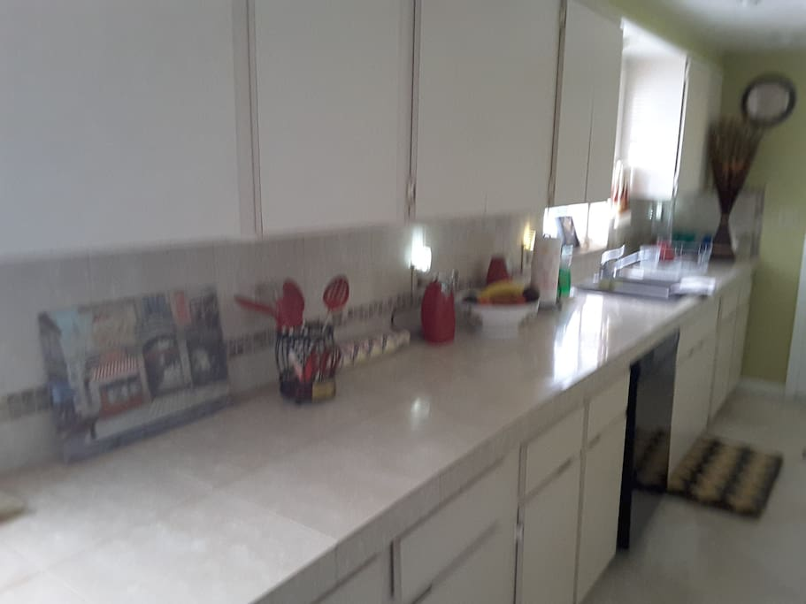 Large kitchen with two sinks.