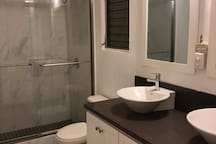 Gorgeous new bathroom with large shower and double vanity.